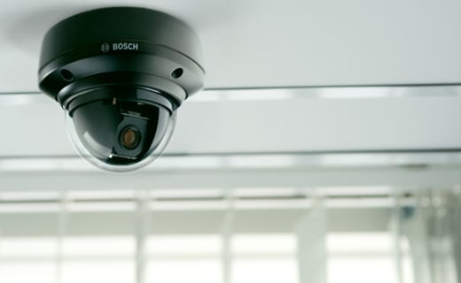 image displays dome cctv camera mounted agains ceiling