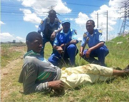 image displays 3 p7p security officers arresting criminal